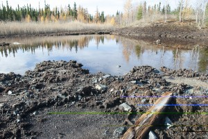 A pond at Hudbay's abandoned Spruce Point mine appears devoid of life. Photo by Eric Reder, Manitoba Wilderness Committee